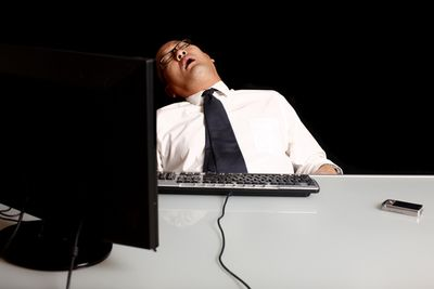 Business Man Asleep at Desk (Image courtesy shutterstock.com)